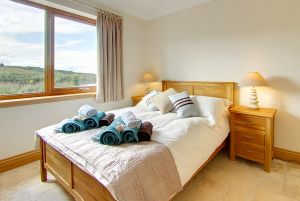 Spacious double bedroom in Inchmalloch Luxury Holiday Cottage, south west Scotland