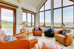 Sunroom in Inchmalloch Holiday Cottage overlooking beautiful Scottish countryside