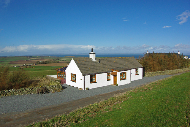 Exterior of The Cotthouse boasting stunning views of the Scottish countryside